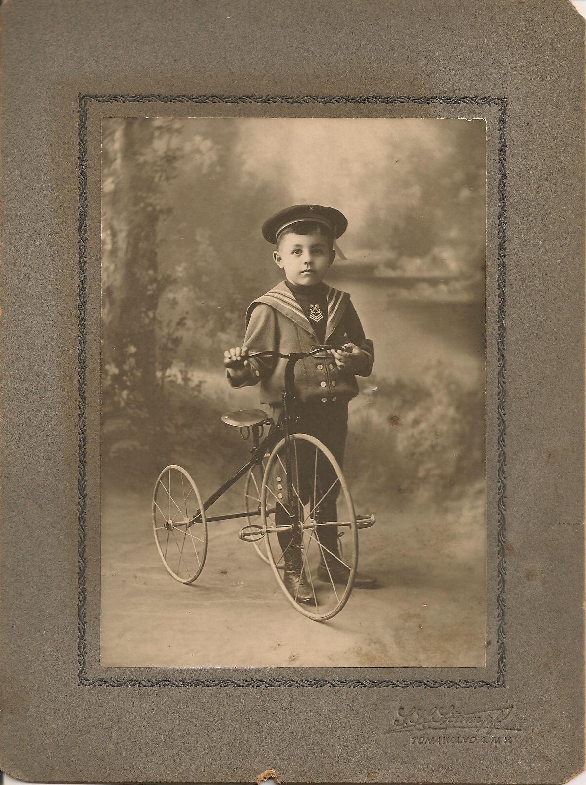 Boy with tricycle, Stumpf, cabinet card (c1900).jpg