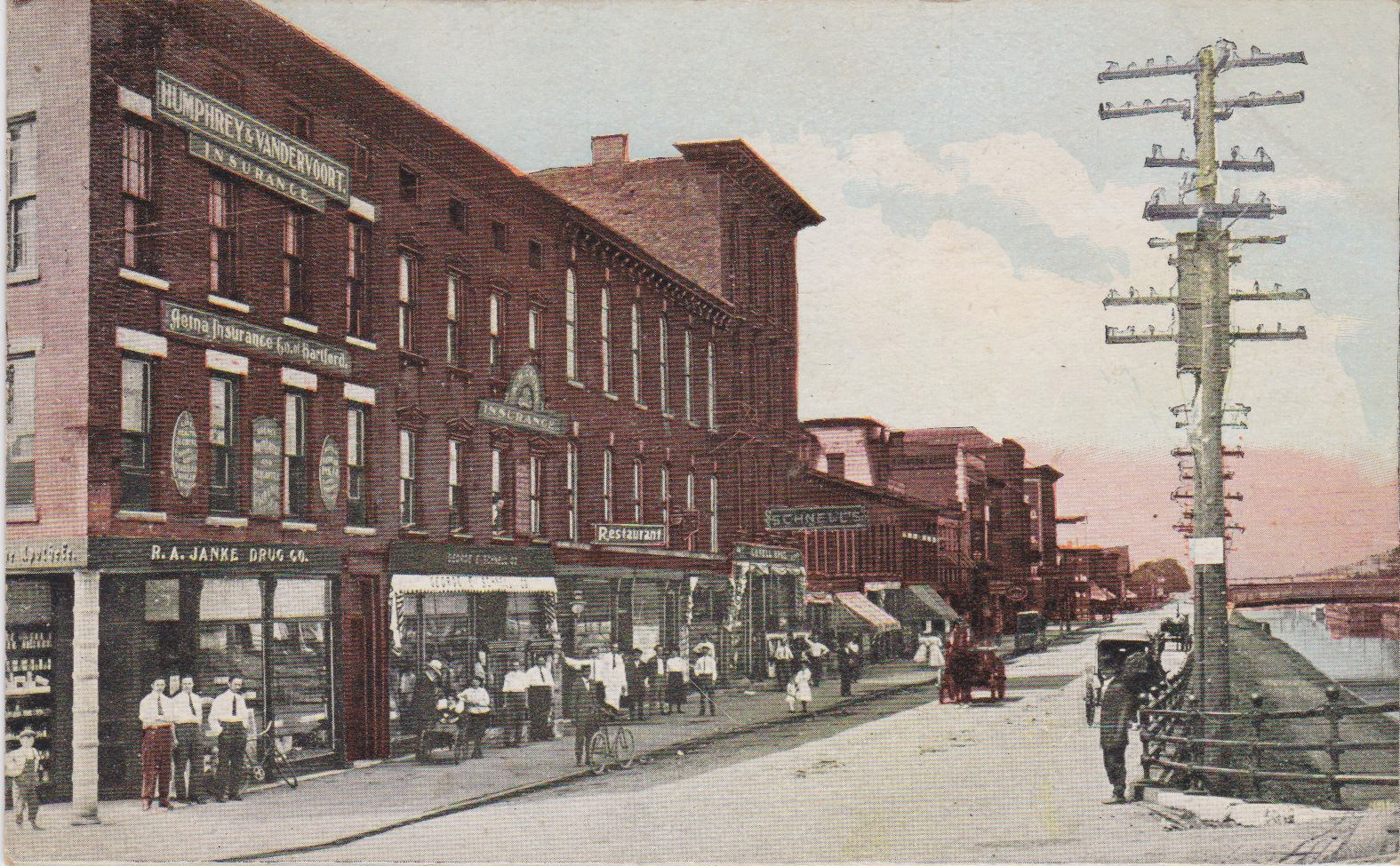 South Niagara Street and Erie Canal, postcard (c 1900).jpg