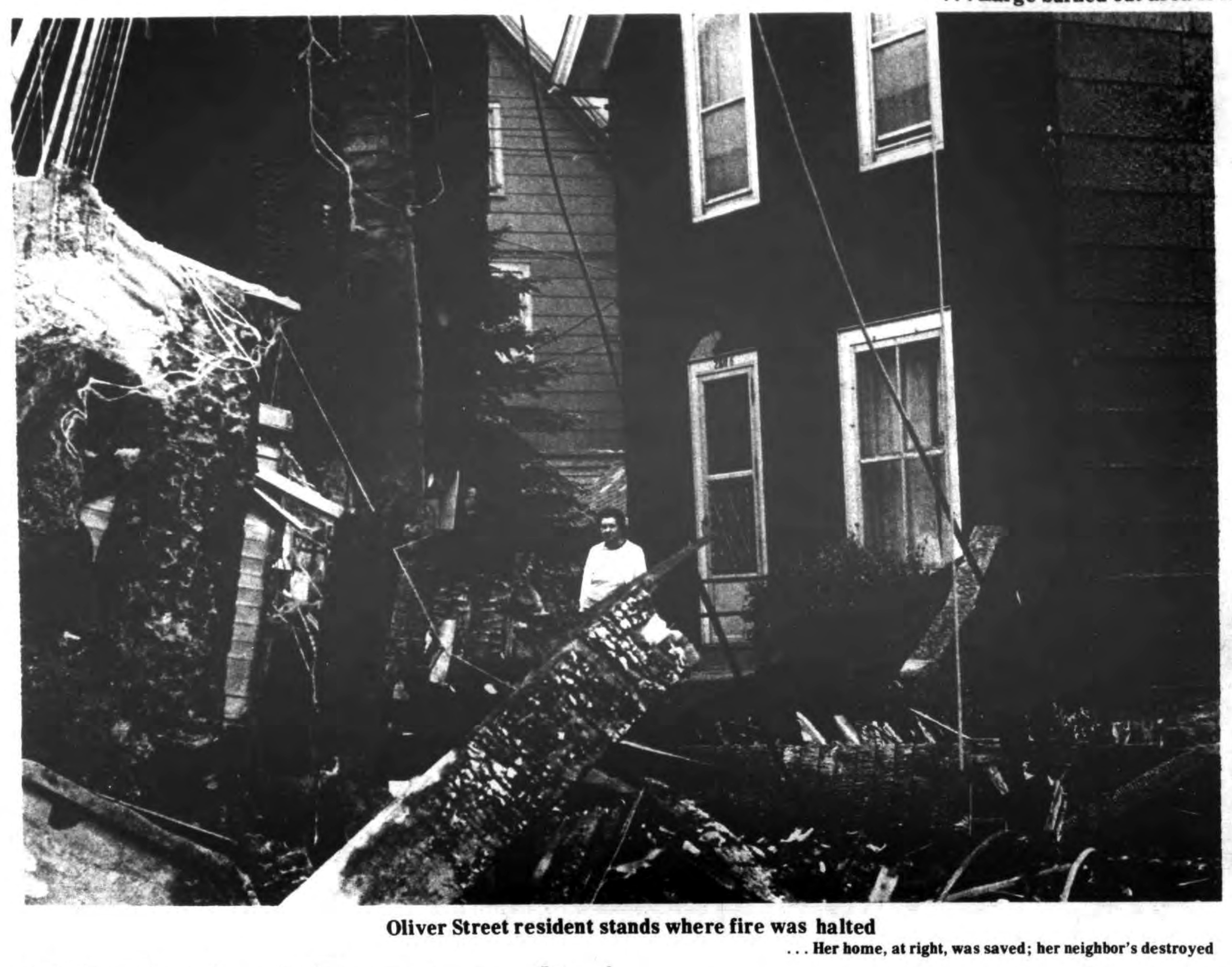 Oliver St resident stands where home was saved, Auto-Wheel fire, photo (Tonawanda News, 1972-05-31).jpg