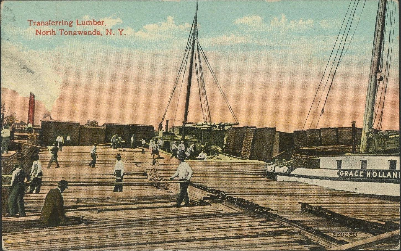 Transferring lumber, postcard (c.1910).jpg