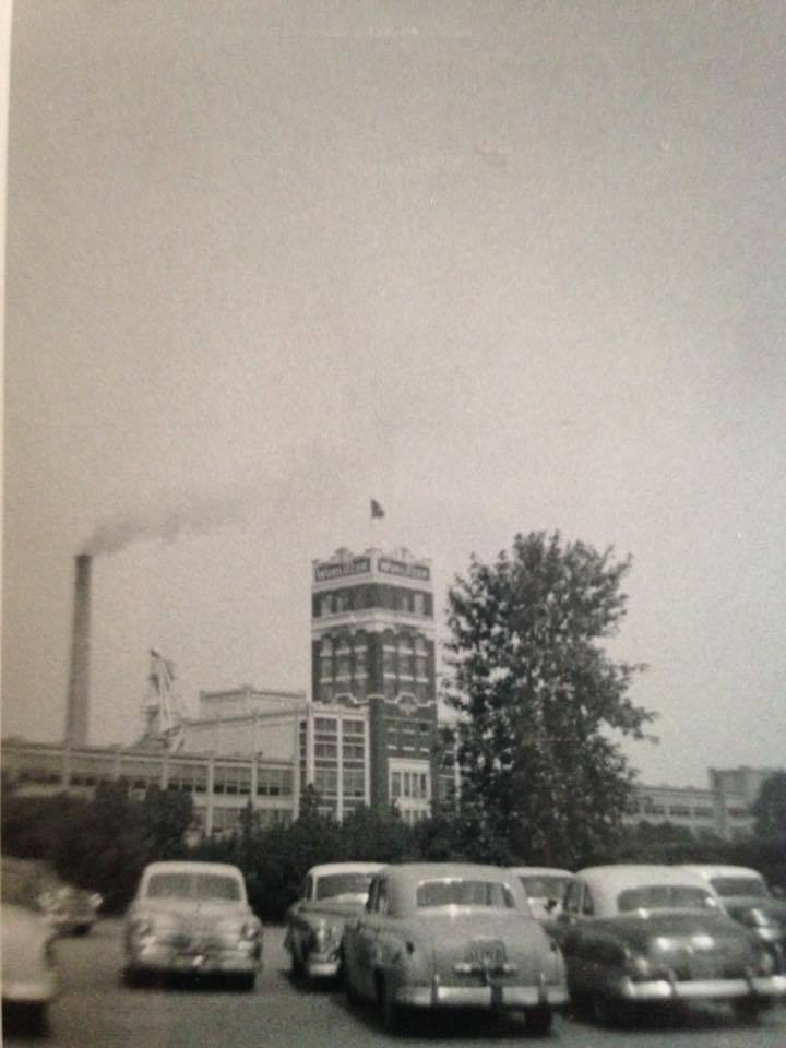 Wurlitzer factory with cars in parking lot, photo (c1950).jpg