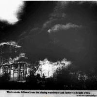 Thick smoke billows from warehouse, photo (Tonawanda News, 1972-05-30).jpg