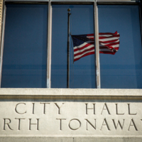 North Tonawanda City Hall with flag reflection, photo (2017).jpg