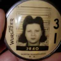 Wurlitzer employee badge of 16 year-old mother (Suzanne DelGatto Coran).jpg