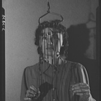 Van Raalte Co, woman with warp holders during wartime conversion, photo (LOC 1942).jpg