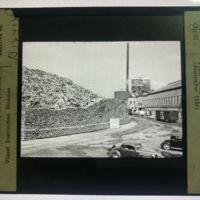 International Paper Company, pile of wood, magic lantern photo (1936).jpg
