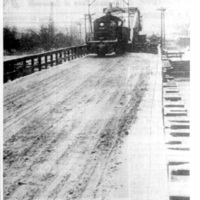 Swing bridge with train, photo from article (Tonawanda News, 1961-02-08).jpg