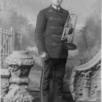Man with musical instrument, photo (Clench Studio, c1890).jpg